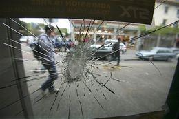 Window broken in Berkley, California protest (AP Photo/Ben Margot)